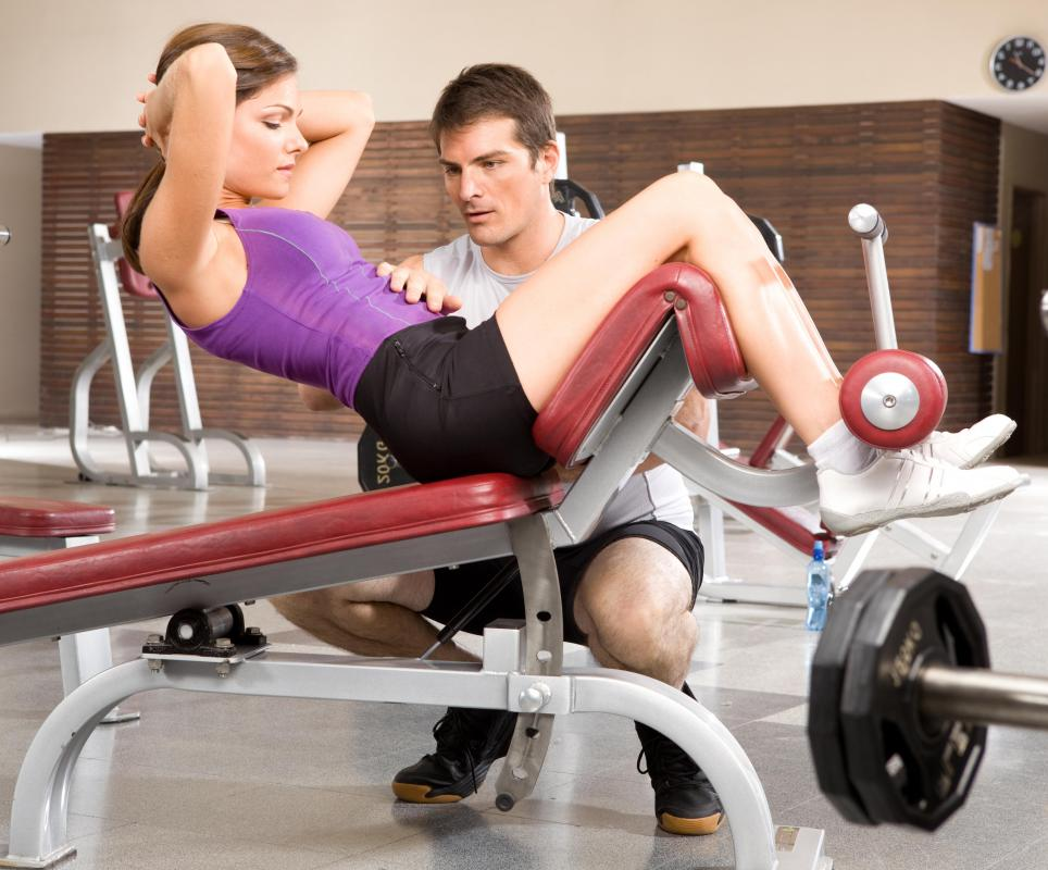 Incline sit-ups can be performed on sit-up benches.