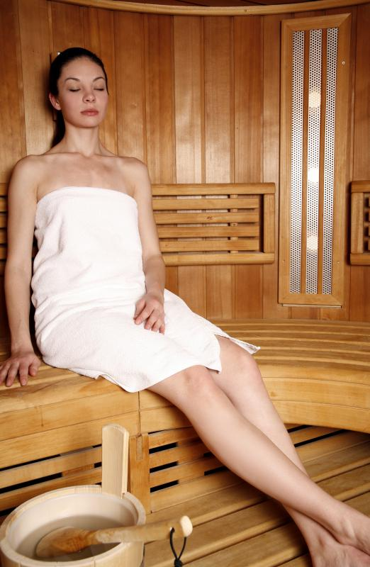 A woman doing a water detox in a sauna.