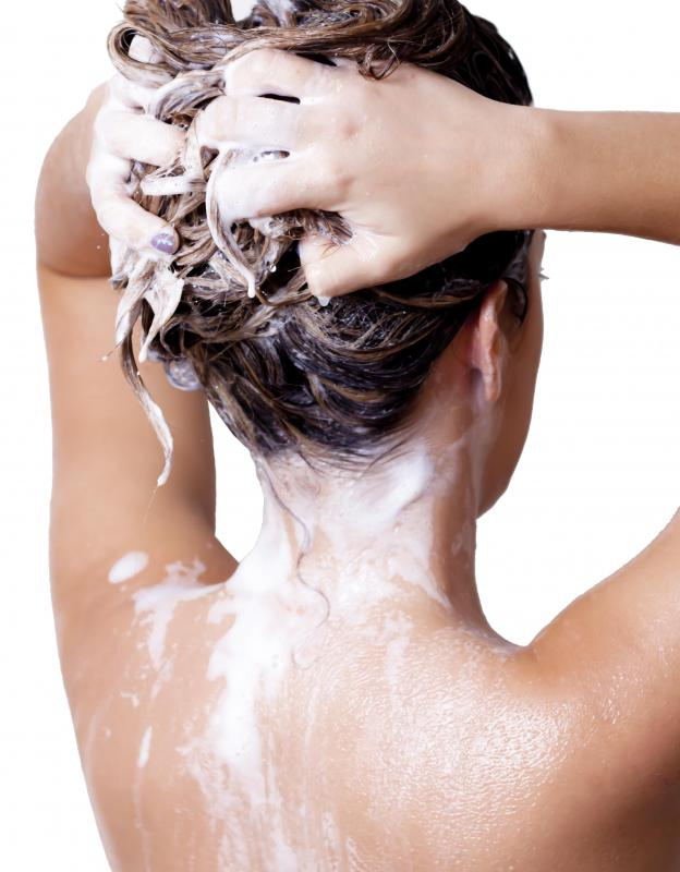 Washing hair with volumizing shampoo and moisturizing conditioners will help curl thick hair.