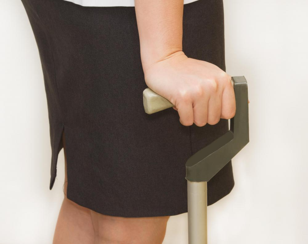 A physiotherapy assistant may help patients who walk with a cane or other device.