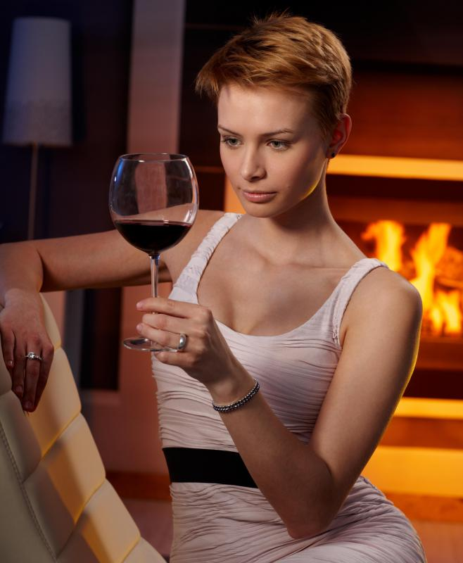 Orchestrating a romantic night with a fireplace and glass of wine can be a nice Valentine's Day gift.