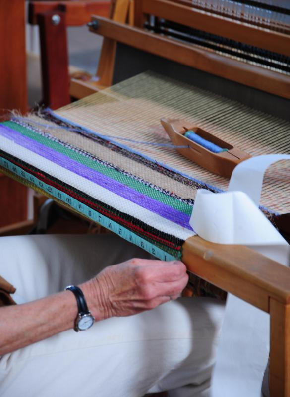 A hand loom is a manually operated fabric weaver.