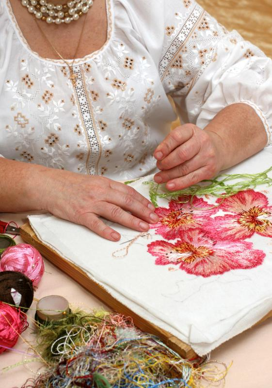 Needlepoint silk is used to stitch on stiff canvas.