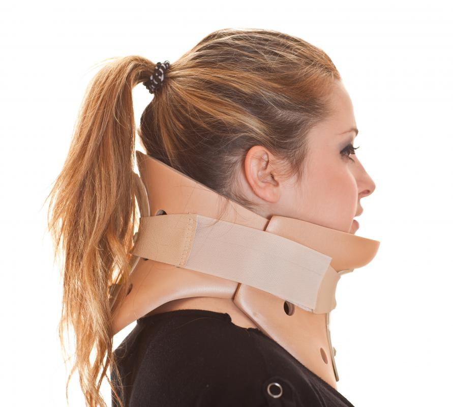A woman wearing a cervical collar for whiplash.
