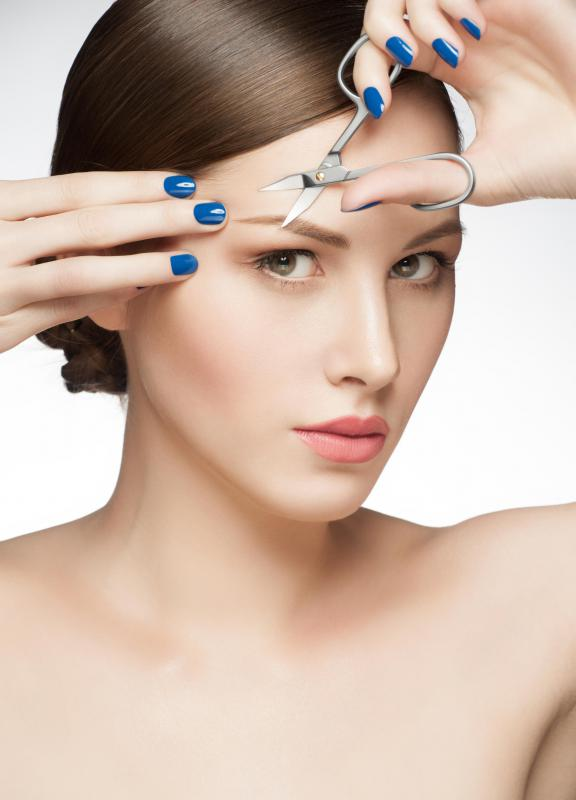 Eyebrows are trimmed to a manageable shape with an eyebrow cut.