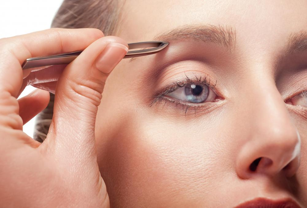 Stray hairs under the brow line should be plucked after the eyebrow is trimmed.