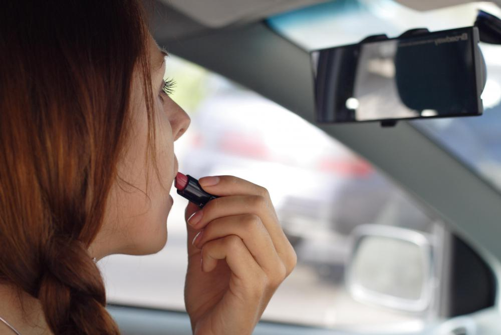 Motorists have divided attention when putting on makeup while driving.