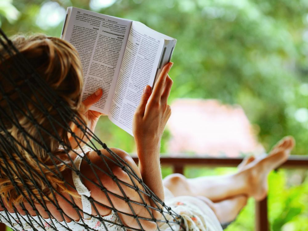 People might spend time catching up on reading while at a resort.