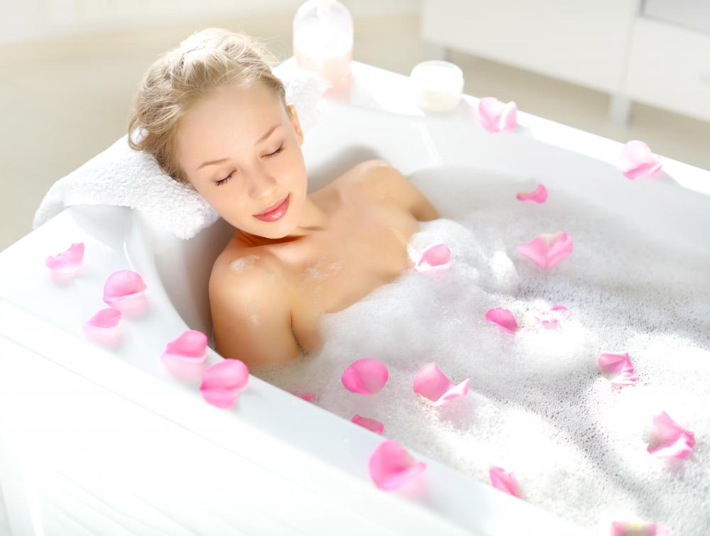 Aromatherapy oil dispensers, candles,  and other relaxation accessories can help bathers unwind.