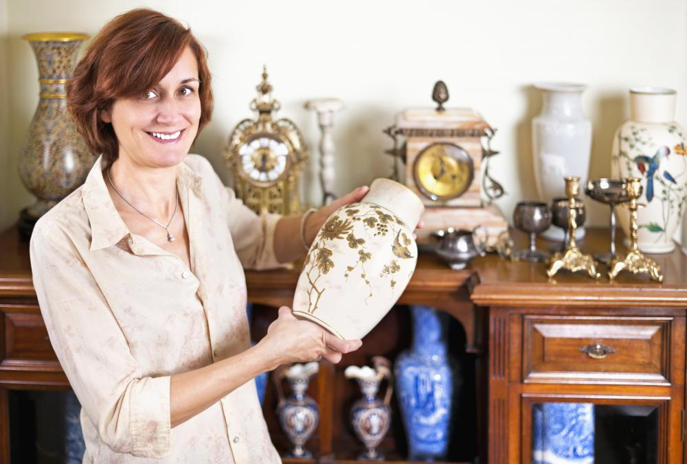 An antique appraiser determines the monetary value of vintage items.