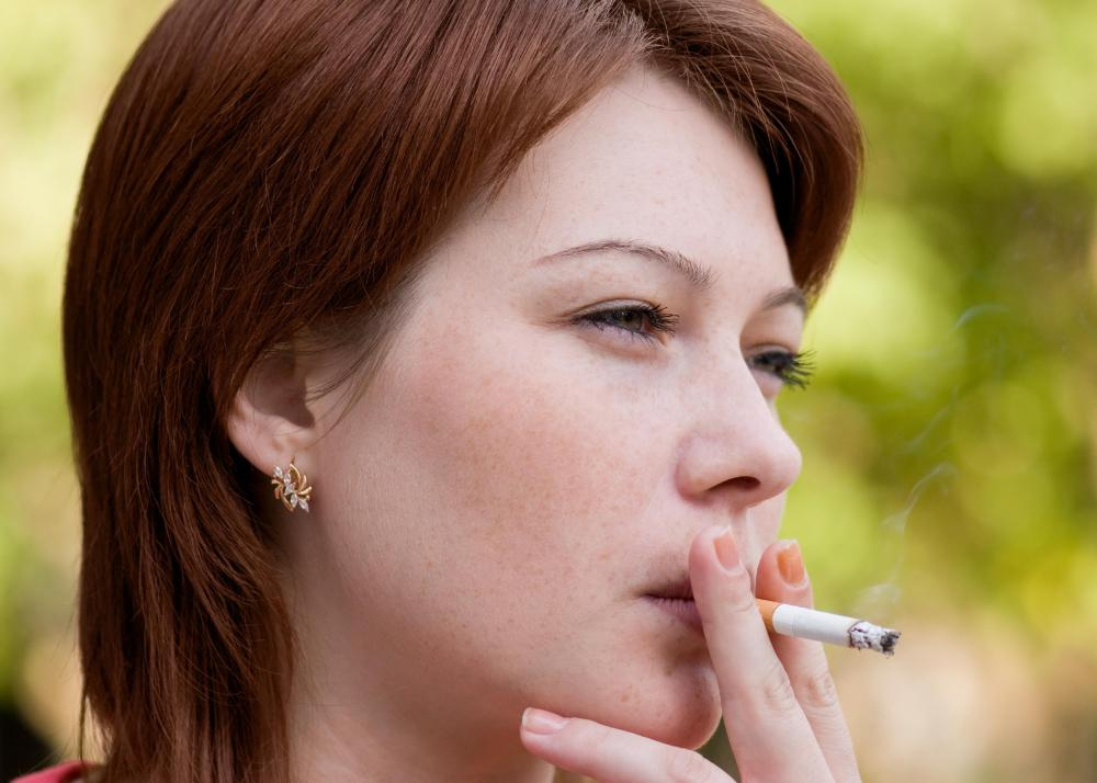 Woman smoking a cigarette.