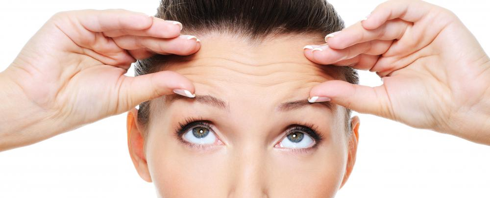 Wrinkles on the forehead often appear in horizontal lines between the eyebrows and the hairline.