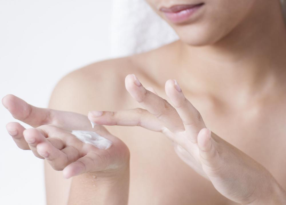 An allergic reaction to skin lotion can cause red, dry skin.
