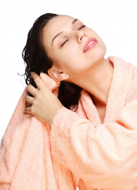 Using a towel to gently blot hair can reduce the stress of styling.