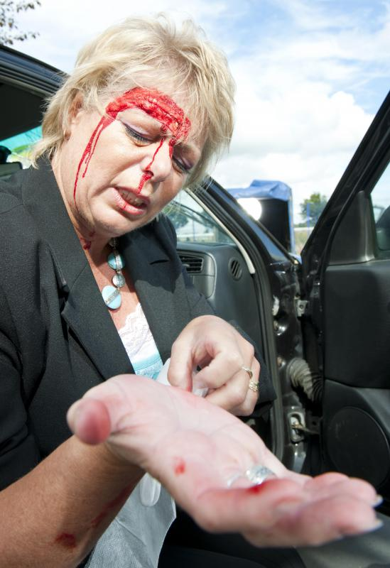 A call to emergency services should be made to treat any injuries sustained in a car accident.