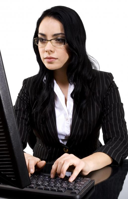 A woman working at a computer terminal.