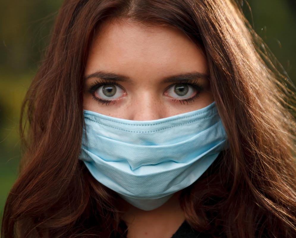 By wearing a face mask, a person with a raspy cough can avoid breathing in allergens, dust and smoke.