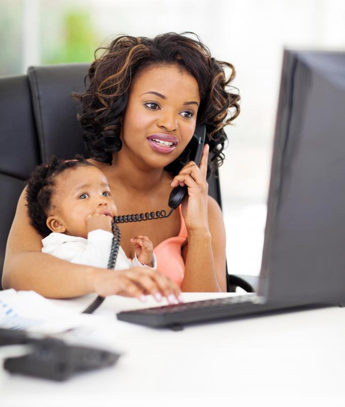 Work at home mothers often have to balance their vocational and parenting duties.