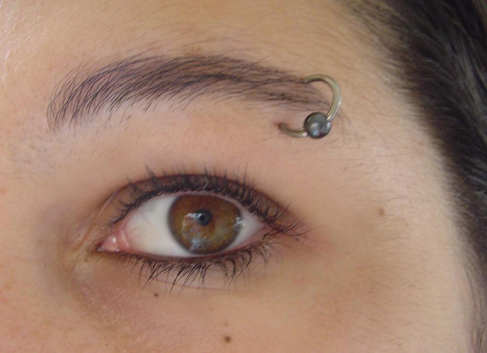 A piercer should provide instructions for caring for an eyebrow ring.