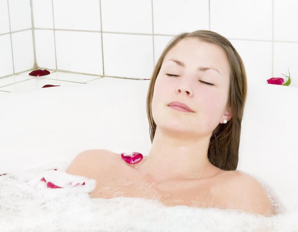 Soaking in a warm bath may help alleviate pain associated with a colon stricture.