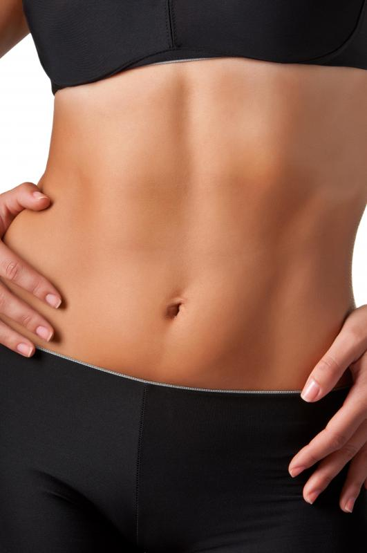 Doing ab crunches helps to tone the stomach area.