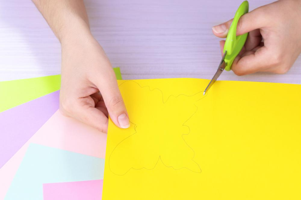 Paper tole project supplies may include different colors of paper and scissors.