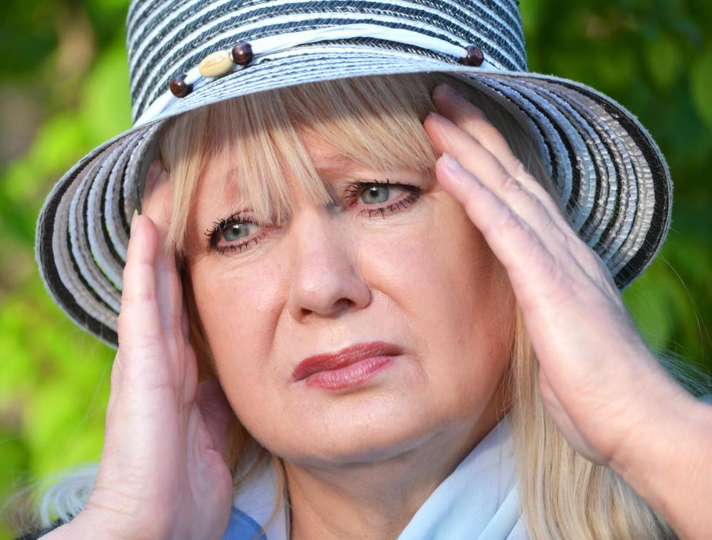 Dizziness and vision disturbances are two possible signs of conversion disorder.