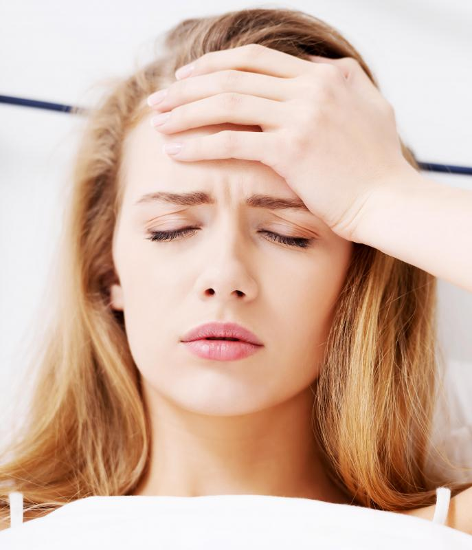 Side effects of heart rhythm medications may include headaches.