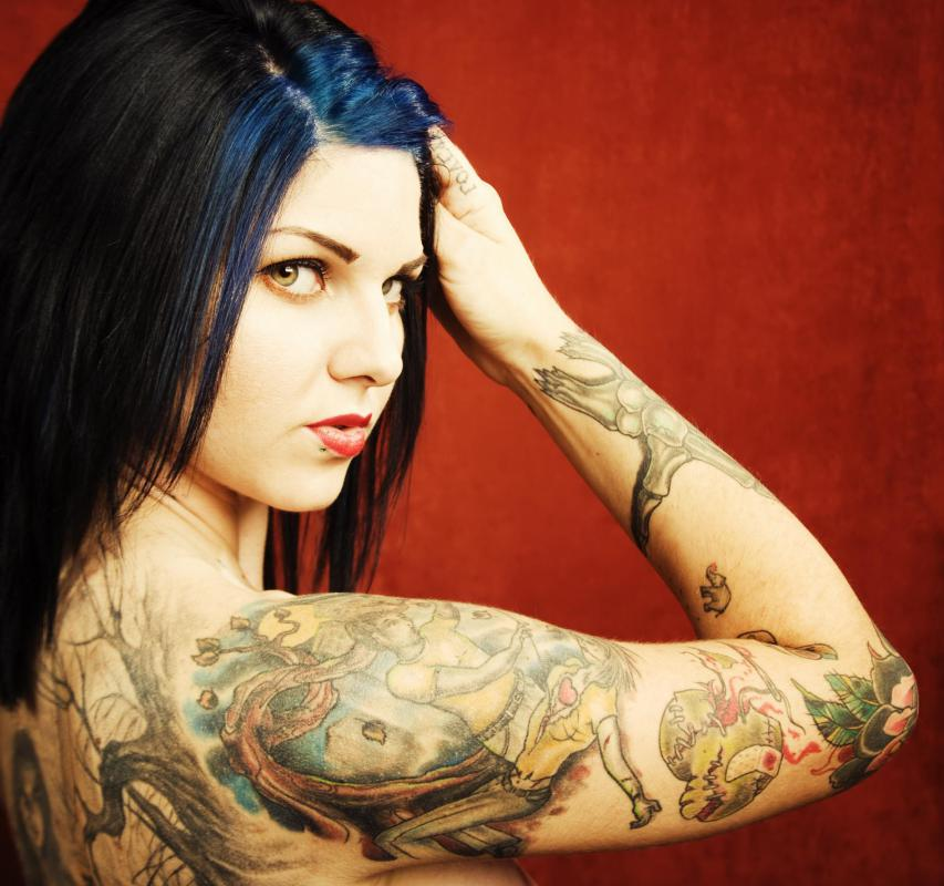 Woman with tattoos on her arm and back.