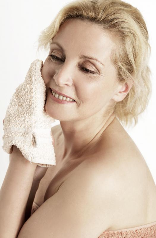 It's usually safe to remove earwax with a washcloth.