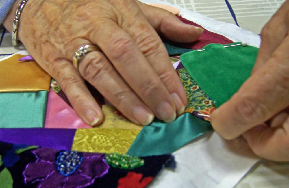 Fabric remnants may be used to make a crazy quilt.