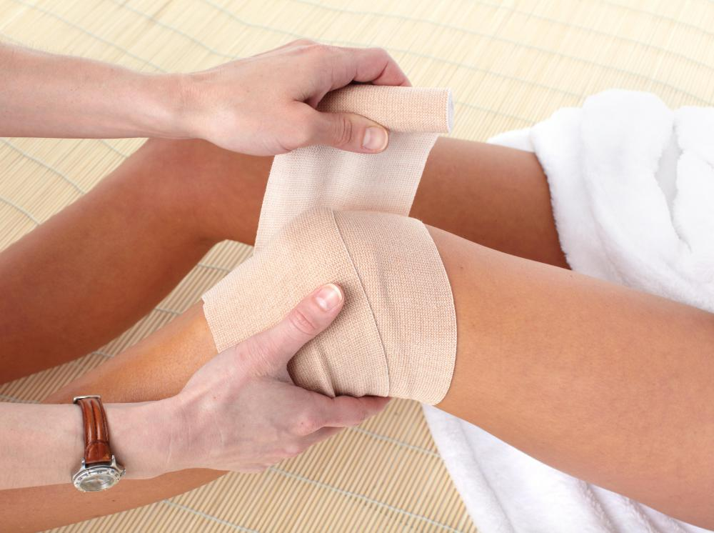 A compression bandage may be used to support a knee while it heals from a torn ligament.