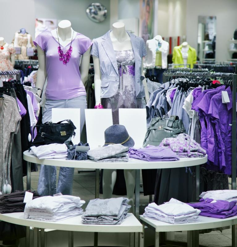 A skilled fashion stylist designs pleasing retail displays.