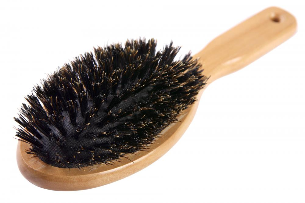 Boar bristle brushes effectively smooth, lift, and help redistribute oil throughout the hair.