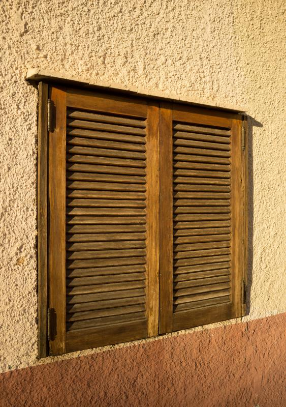 Shutters on windows should hang evenly and be well-maintained.