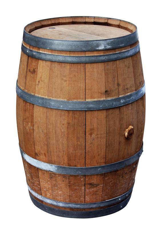 A wooden barrel can be used to collect rain to water plants.
