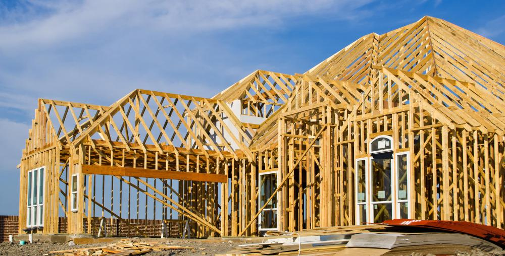 Roof construction is often carried out after the basic framing is complete.
