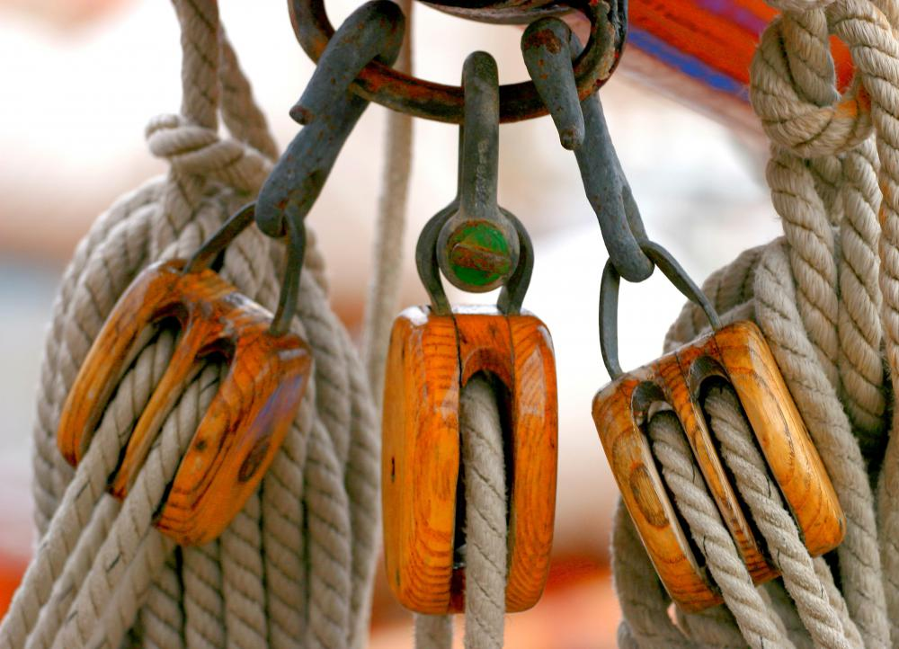 Wooden rope pulley blocks on a boat.