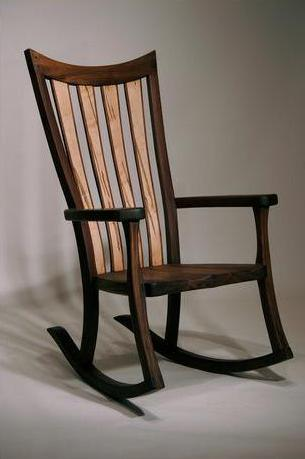 the rounded base of a rocking chair allows sitters to move in a back and forth motion while they sit