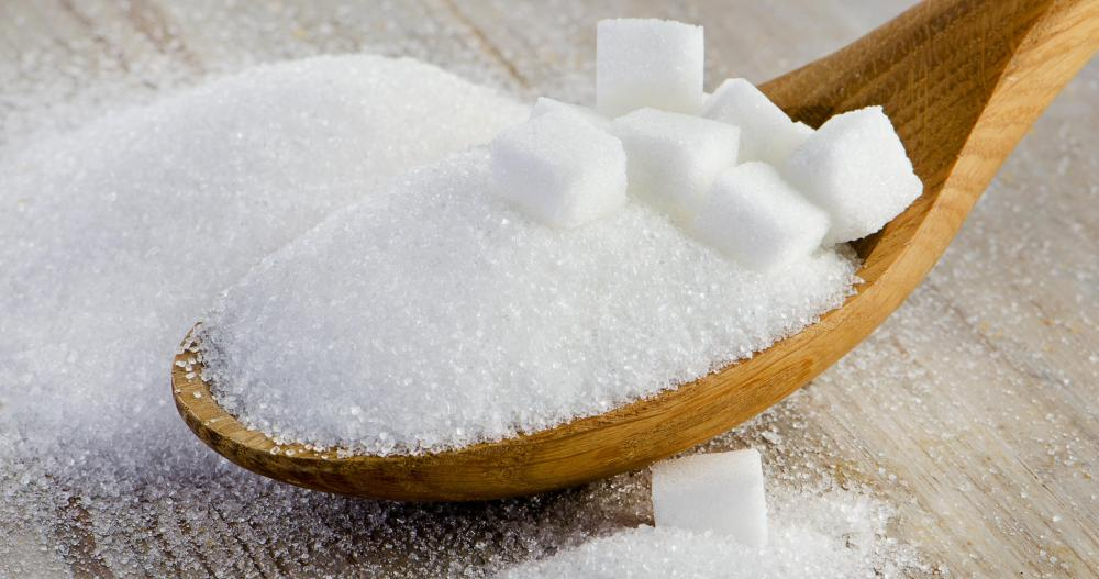 Sugar, a common ingredient in body scrubs, helps exfoliate dry skin on the hands.