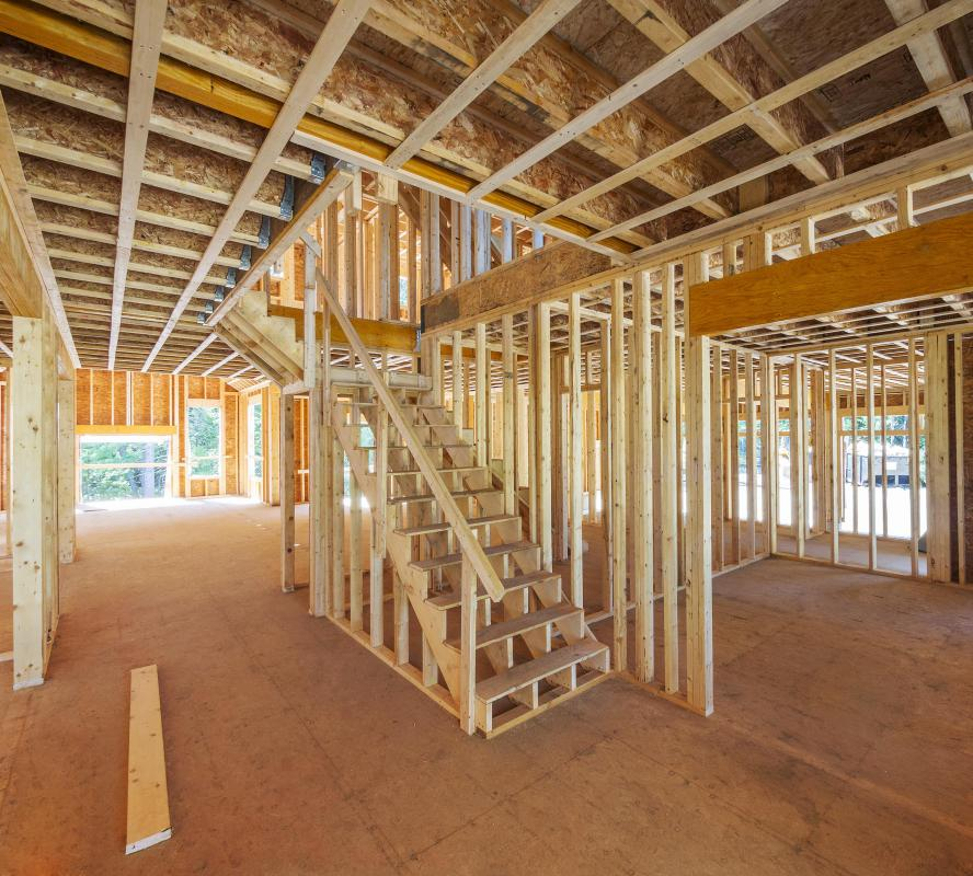 One of the most popular cuts of pressure treated lumber for home building is the two-by-four, which actually measures 1.5 inches by 3.5 inches.