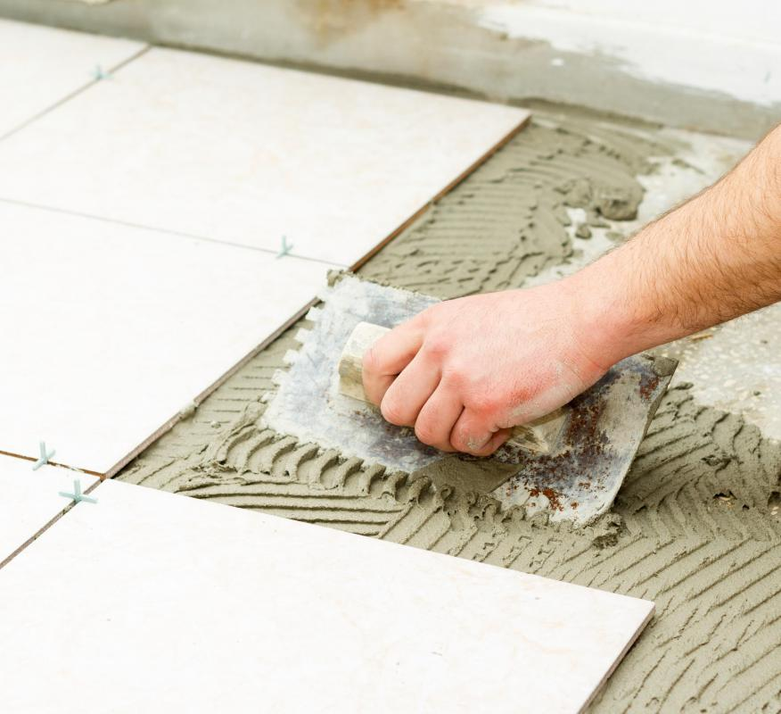 Water damage may require repairing the subfloor and installing new tile.