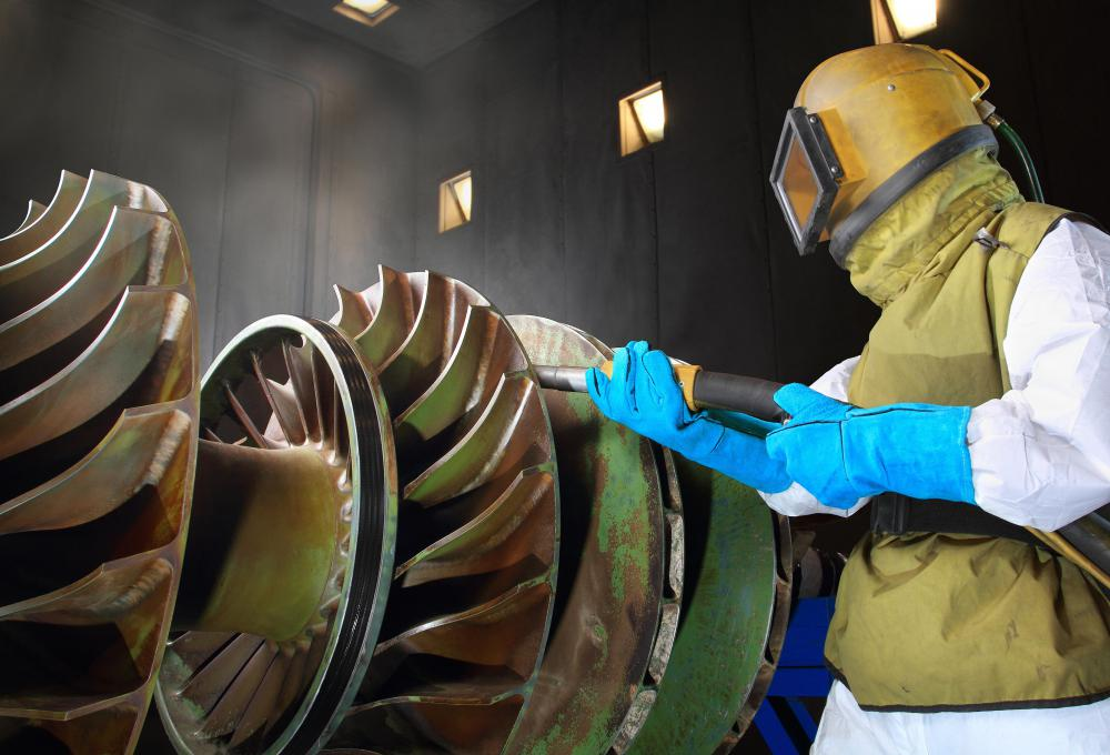 The axis of a turbine is lined with rotating blades that either compress fluids or are turned by them.