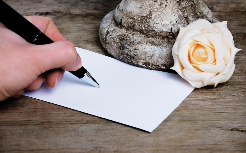 Writing words of condolence on a blank card is generally considered more appropriate than buying a pre-printed card.