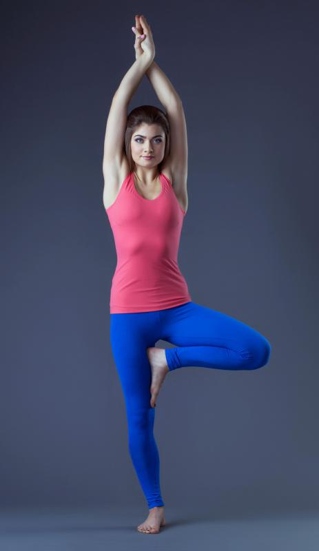 A tank top and leggings are appropriate clothing for yoga.