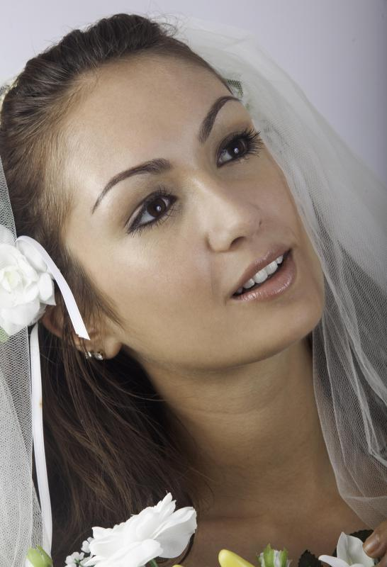 Hairstylists can help a bride get ready on her wedding day.