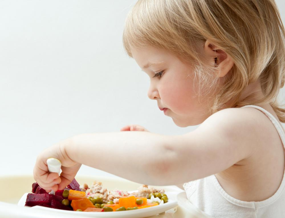Self-feeding with utensils helps children develop fine motor skills.