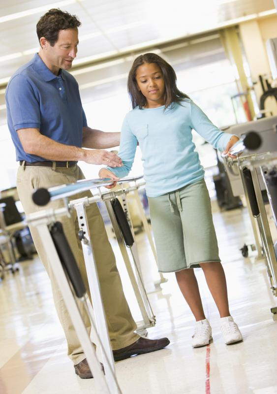 Knee replacement surgery recovery might include walking with the use of parallel bars.