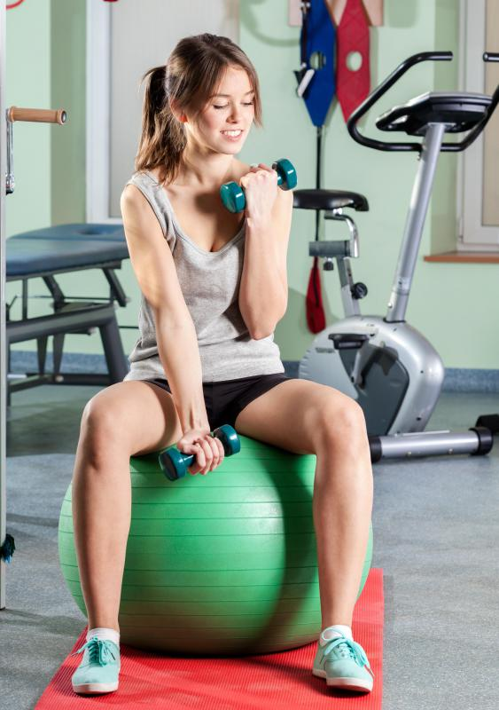 A Swiss ball can be used during exercise and weight lifting practices.