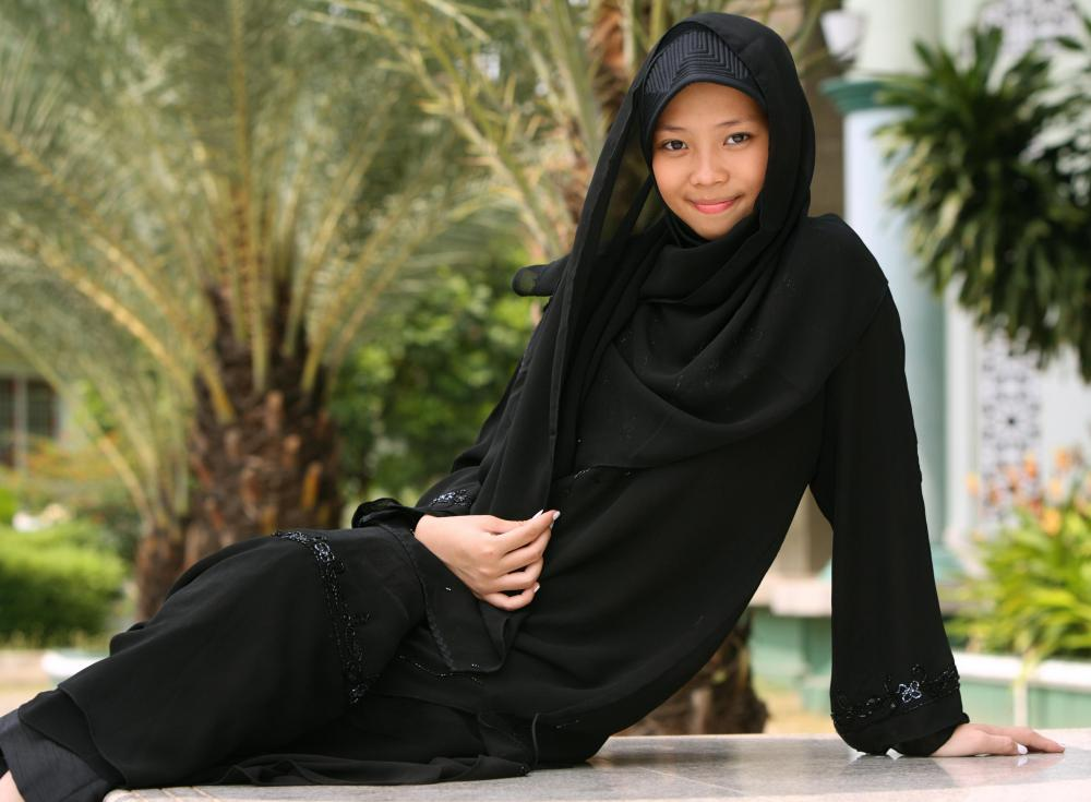A jilbab is designed to cover the entire body except for the hands, face, and feet.